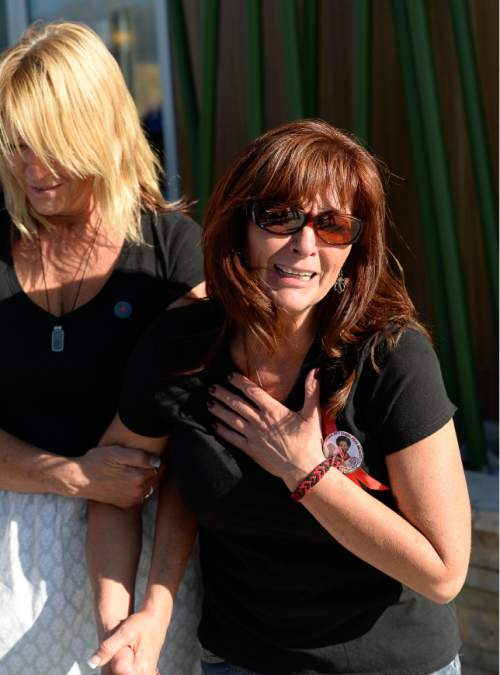 Francisco Kjolseth   The Salt Lake Tribune Susan Hunt is overcome with emotion as she remembers her son's final walk. On the one-year anniversary of the death of Darrien Hunt at the hands of police, family, friends and supporters gathered to remember him in Saratoga Springs.