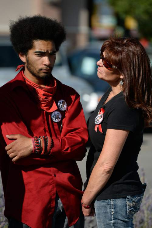 Francisco Kjolseth | The Salt Lake Tribune Kerahn Hunt, brother of Darrien Hunt who was killed one-year ago at the hands of police, is joined by his mother Susan, outside the Panda Express in Saratoga Springs where Darrien was gunned down on the sidewalk.