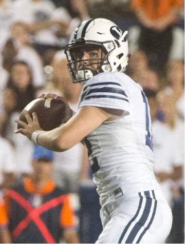 Rick Egan  |  The Salt Lake Tribune   Brigham Young Cougars quarterback Tanner Mangum (12) loos for an open man, in college football action, BYU vs. Boise State at Lavell Edwards Stadium, Saturday, September 12, 2015.