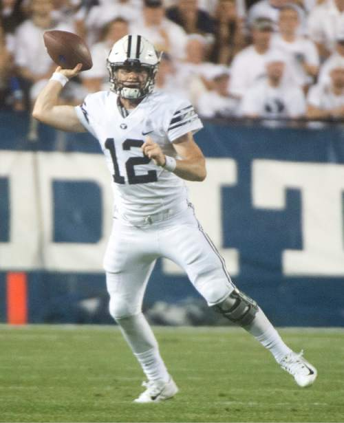 Rick Egan  |  The Salt Lake Tribune  Brigham Young Cougars quarterback Tanner Mangum (12) looks for an open man, in college football action, BYU vs. Boise State at Lavell Edwards Stadium, Saturday, Sept. 12, 2015.