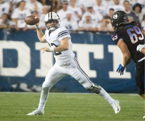 Rick Egan  |  The Salt Lake Tribune  Brigham Young Cougars quarterback Tanner Mangum (12) throws the ball, in college football action, BYU vs. Boise State at Lavell Edwards Stadium, Saturday, Sept. 12, 2015.