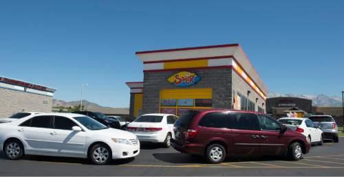 Rick Egan  |  The Salt Lake Tribune  Cars line up at Swig in Lehi, Monday, July 30, 2015.
