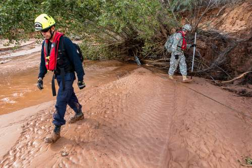 Trent Nelson  |  The Salt Lake Tribune Searchers from Utah Task Force One and the Utah National Guard comb a wash, looking for the remaining victim of a flash flood, in Hildale, Wednesday September 16, 2015.