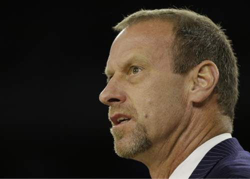 Utah head coach Larry Krystkowiak watches during the first half of a college basketball regional semifinal game against Duke in the NCAA Tournament Friday, March 27, 2015, in Houston. (AP Photo/David J. Phillip)