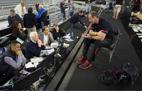 Steve Griffin  |  The Salt Lake Tribune  University of Utah head coach Larry Krystkowiak talks with the national media broadcast anchors as his team practices on the NRG Stadium court prior to their 2015 NCAA Men's Basketball Championship Regional Semifinal game against Duke in Houston, Thursday, March 26, 2015.