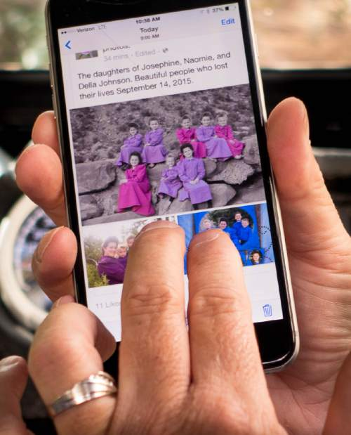Trent Nelson  |  The Salt Lake Tribune A Facebook post on a cell phone shows an image of some of the victims of the flash flood incident in Hildale, Wednesday September 16, 2015.