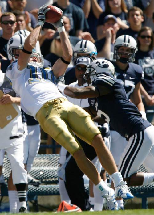 Rick Egan     The Salt Lake Tribune  UCLA WR Gavin Ketchum (10) goes into the air for a pass as BYU defensive back Brandon Bradley (5) shoves him out of bounds for an incomplete pass, in football action, BYU vs UCLA at Lavell Edwards Stadium in Provo.  The Cougars shut out the Bruins 59-0 Saturday, September 13, 2008.