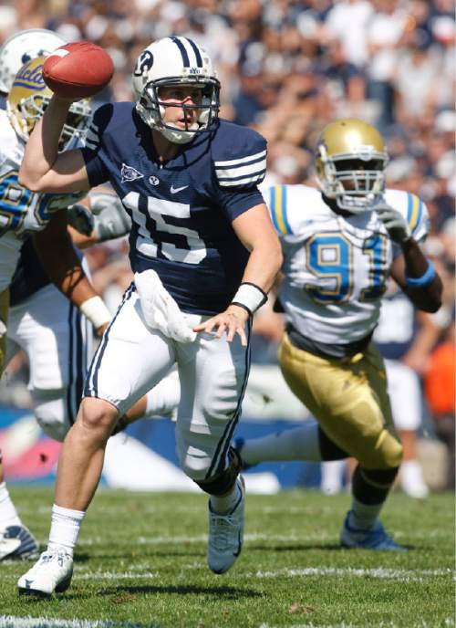 Rick Egan     The Salt Lake Tribune   BYU quarterback Max Hall (15) runs the offense in the first half, in football action, BYU vs UCLA at Lavell Edwards Stadium in Provo.  The Cougars shut out the Bruins 59-0 Saturday, September 13, 2008.