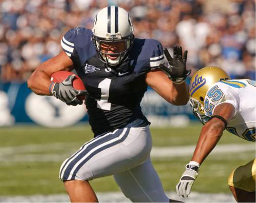 Rick Egan     The Salt Lake Tribune  BYU running back Fui Vakapuna (1) runs the ball for the cougars, in football action, BYU vs UCLA at Lavell Edwards Stadium in Provo.  The Cougars shut out the Bruins 59-0 Saturday, September 13, 2008.