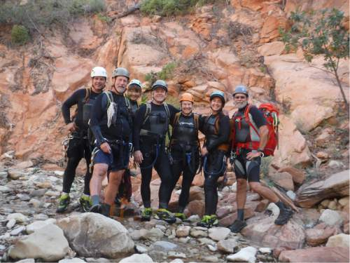 |  Courtesy Zion National Park   Portrait of the group standing before the first rappel of Keyhole Canyon on Monday, September 14, 2015.  Photographed from left to right: Gary Favela, Don Teichner, Muku Reynolds, Steve Arthur, Linda Arthur, Robin Brum, and Mark MacKenzie.