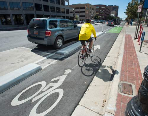 Steve Griffin  |  The Salt Lake Tribune  A bike pedals along in the new bike lanes on 300 South near State Street in Salt Lake City, Friday, September 18, 2015.