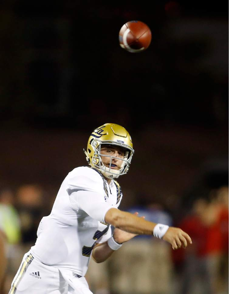 UCLA quarterback Josh Rosen throws a pass during the first half of an NCAA football game against UNLV Saturday, Sept. 12, 2015, in Las Vegas. (AP Photo/Isaac Brekken)