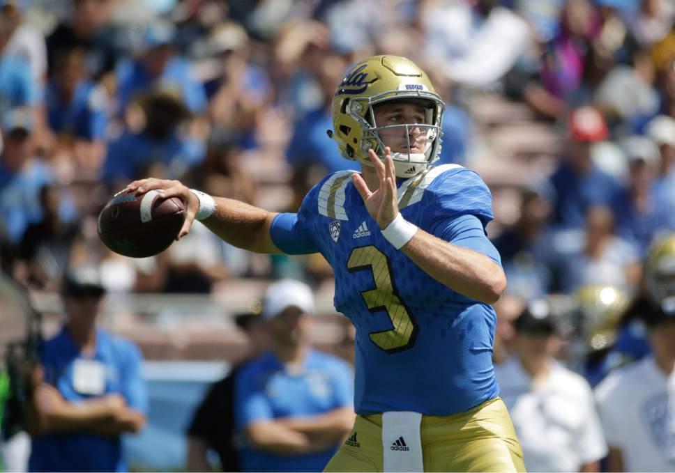 UCLA quarterback Josh Rosen throws a pass during the first half of an NCAA college football game against Virginia at the Rose Bowl, Saturday, Sept. 5, 2015, in Pasadena, Calif. (AP Photo/Jae C. Hong)