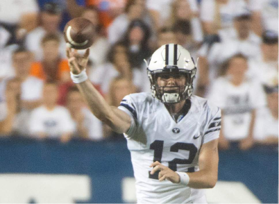 Rick Egan     The Salt Lake Tribune  Brigham Young Cougars quarterback Tanner Mangum (12) throws the ball, in college football action, BYU vs. Boise State at Lavell Edwards Stadium, Saturday, Sept. 12, 2015.