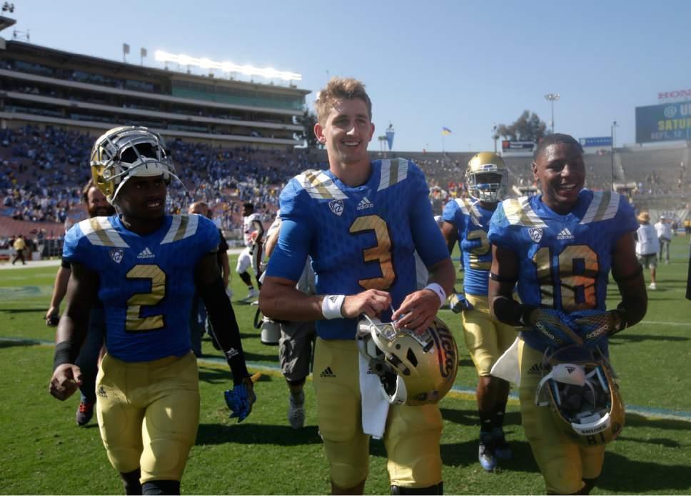 UCLA quarterback Josh Rosen, center, walks off the field after an NCAA college football game against Virginia at Rose Bowl, Saturday, Sept. 5, 2015, in Pasadena, Calif. UCLA won 34-16. (AP Photo/Jae C. Hong)