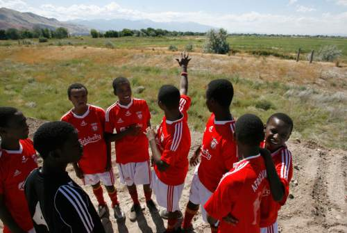 Francisco Kjolseth  |  The Salt Lake Tribune Youth soccer players from the Africa United team that practice at West Pointe Park overlook the area that will eventualy become 16 new soccer fields. Mayor Ralph Becker, City Councilman Carlton Christensen and Real Salt Lake (RSL) owner Dell Loy Hansen invited the public and media representatives to participate in an event recognizing both the official re-start of construction on the City's voter-approved Regional Athletic Complex (RAC) and RSL's gift of $7.5 million to help complete the project.