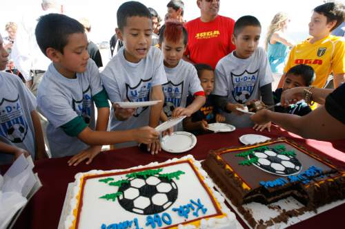 Francisco Kjolseth  |  The Salt Lake Tribune Young soccer members of the Utah Development Academy are finally rewarded with cake after standing through speeches by Mayor Ralph Becker, City Councilman Carlton Christensen and Real Salt Lake (RSL) owner Dell Loy Hansen who invited the public and media representatives to participate in an event recognizing both the official re-start of construction on the City's voter-approved Regional Athletic Complex (RAC) and RSL's gift of $7.5 million to help complete the project. The soccer complex property, near 2100 North Rose Park Lane will feature 16 new fields to be completed in the Summer of 2015.