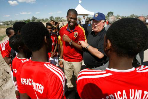Francisco Kjolseth  |  The Salt Lake Tribune  Real Salt Lake (RSL) owner Dell Loy Hansen, center left, jokes around with RSL defender Kwame Watson-Siriboe as they meet members of the Africa United youth team following an event to recognize both the official re-start of construction on the City's voter-approved Regional Athletic Complex (RAC) and RSL's gift of $7.5 million to help complete the project near 2100 North Rose Park Lane on Thursday, August 1, 2013.