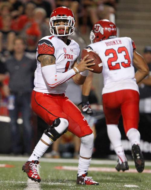 Utah quarterback Kendal Thompson drops back to pass against Fresno State during the first half of an NCAA college football game in Fresno, Calif., Saturday, Sept. 19, 2015. (AP Photo/Gary Kazanjian)