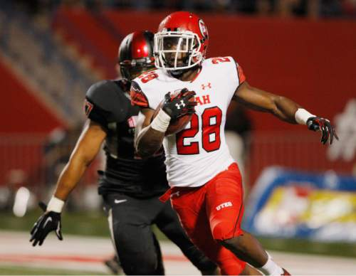 Utah running back Joe Williams (28) carries past Fresno State's Kyrie Wilson during the first half of an NCAA college football game in Fresno, Calif., Saturday, Sept. 19, 2015. (AP Photo/Gary Kazanjian)