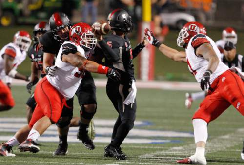 Utah's Viliseni Fauonuku and Kylie Fitts force a fumble against Fresno State quarterback Chason Virgil for a touchdown during the first half of an NCAA college football game in Fresno, Calif., Saturday, Sept. 19, 2015. (AP Photo/Gary Kazanjian)