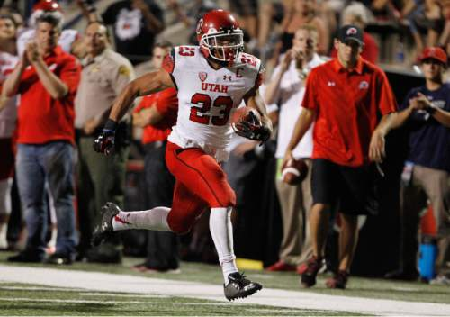 Utah running back Devontae Booker (23) rushes for a touchdown against Fresno State during the first half of an NCAA college football game in Fresno, Calif., Saturday, Sept. 19, 2015. (AP Photo/Gary Kazanjian)
