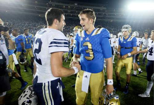 BYU quarterback Tanner Mangum, left, and UCLA quarterback Josh Rosen, right greet each other after their NCAA college football game, Saturday, Sept. 19, 2015, in Pasadena, Calif. UCLA won 24-23. (AP Photo/Danny Moloshok)