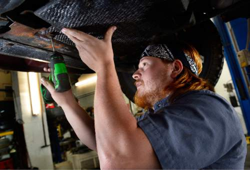 Scott Sommerdorf   |  The Salt Lake Tribune Justin Watson, a mechanic at The Mechanic Man, examines a 2001 Chevrolet Suburban that was in for repairs, Thursday, September 17, 2015.