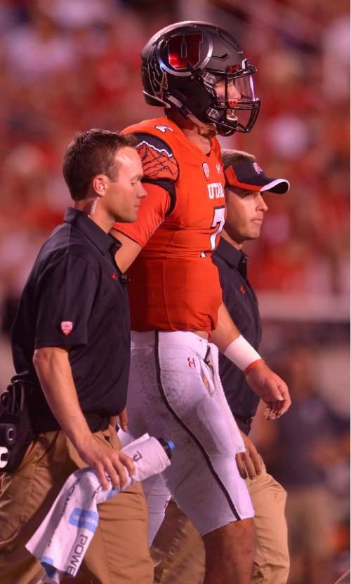 Leah Hogsten  |  The Salt Lake Tribune Utah Utes quarterback Travis Wilson (7) leaves the game after an injury. University of Utah is tied with Utah State 14-14 at halftime at Rice-Eccles Stadium, Friday, September 11, 2015.