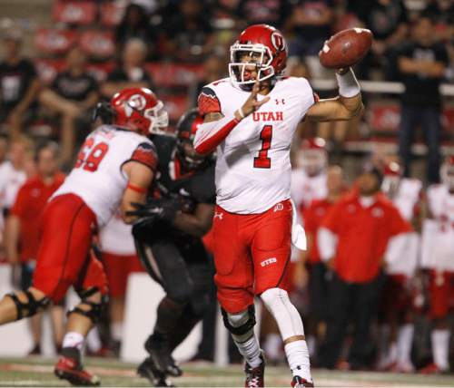 Utah's Kendal Thompson drops back to pass against  Fresno State during the second half of an NCAA college football game in Fresno, Calif., Saturday, Sept. 19, 2015. (AP Photo/Gary Kazanjian)