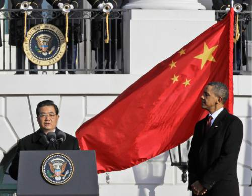 FILE - In this Jan. 19, 2011 file photo, President Barack Obama listens as China's President Hu Jintao speaks during a state arrival on the South Lawn of the White House in Washington.  Another visited Disneyland and Hollywood. Chinese President Xi Jinping's trip to the U.S. mid-September, 2015, is the latest in a string of visits made over the years by China's leaders since formal diplomatic relations were established between Washington and Beijing in 1979.  (AP Photo/Charles Dharapak, File)