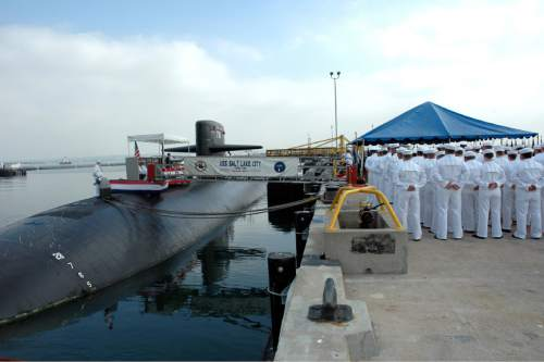 San Diego, Calif. (Oct. 26, 2005) – The crew of the Los Angeles Class fast attack submarine USS Salt Lake City (SSN 716) stand in ranks during the inactivation ceremony for Salt Lake City at Naval Base Point Loma. Salt Lake City was launched on October 16, 1982 and commissioned on May 12, 1984. (U.S. Navy photo by Photographer's Mate 3rd Class Timothy F. Sosa.)
