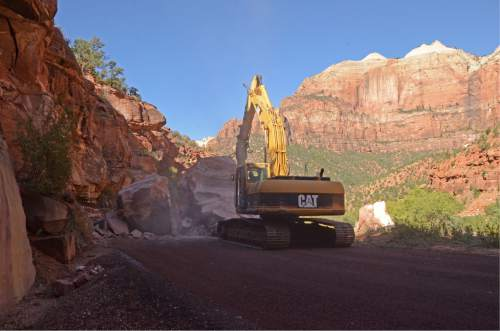 Courtesy  |  Zion National Park  Crews break up boulders to remove them from the roadway Wednesday, Sep. 23, 2015. The largest boulder is estimated to be 200 tons, at 19 feet high by 20 feet long and 15 feet wide. The second boulder is 100 tons, at 10 feet high, 10 feet long and 15 feet wide.