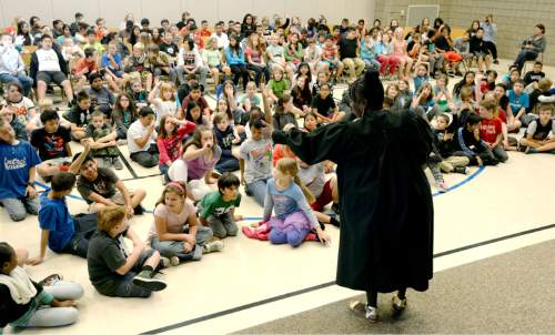 Steve Griffin     The Salt Lake Tribune  Salt Lake County Justice Court Judge Shauna Graves-Robertson talks with students at Nibley Park Elementary about her life during their 6th annual History Makers program in Salt Lake City, Thursday, September 24, 2015.