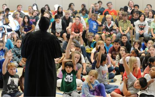 Steve Griffin  |  The Salt Lake Tribune  Salt Lake County Justice Court Judge Shauna Graves-Robertson talks with students at Nibley Park Elementary about her life during their 6th annual History Makers program in Salt Lake City, Thursday, September 24, 2015.