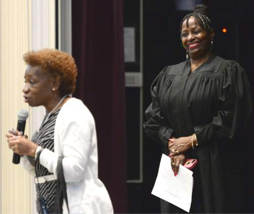 Steve Griffin  |  The Salt Lake Tribune  Salt Lake County Justice Court Judge Shauna Graves-Robertson, right, smiles as her friend and Nibley Park Elementary school principal, Frances Battle, thanks her for speaking during the school's 6th annual History Makers program in Salt Lake City, Thursday, September 24, 2015.