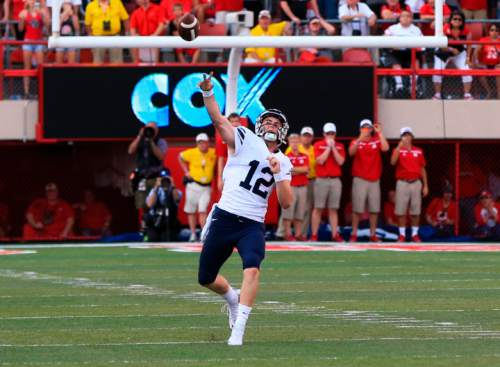 BYU quarterback Tanner Mangum throws a 42-yard Hail Mary with no time left, which was caught for the game-winning touchdown by wide receiver Mitch Mathews, unseen, giving BYU a 33-28 victory over Nebraska in an NCAA college football game in Lincoln, Neb., Saturday, Sept. 5, 2015. (AP Photo/Nati Harnik)