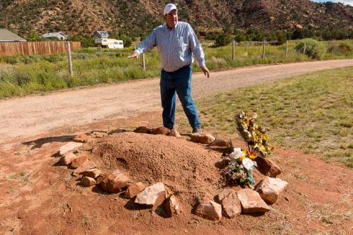 Trent Nelson     The Salt Lake Tribune Dee Barlow stands over Walter Steed's grave at the Isaac W Carling Memorial Park Cemetery in Colorado City, Arizona, Wednesday September 16, 2015.