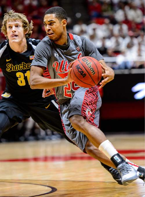Trent Nelson  |  The Salt Lake Tribune Utah Utes guard Kenneth Ogbe (25) drives on Wichita State Shockers guard Ron Baker (31) as the University of Utah Utes host the Wichita State Shockers, college basketball at the Huntsman Center in Salt Lake City, Wednesday December 3, 2014.