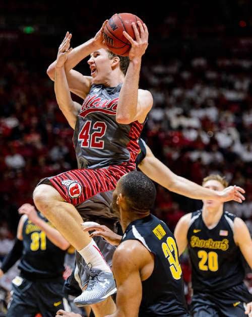 Trent Nelson  |  The Salt Lake Tribune Utah Utes forward Jakob Poeltl (42) shoots the ball as the University of Utah Utes host the Wichita State Shockers, college basketball at the Huntsman Center in Salt Lake City, Wednesday December 3, 2014.