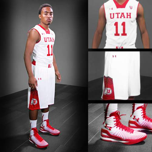 | Courtesy Utah athletics  Brandon Taylor poses in the white variation of Utah men's basketball uniforms. The new outfits, designed by Under Armour, will be worn for the 2014 season.