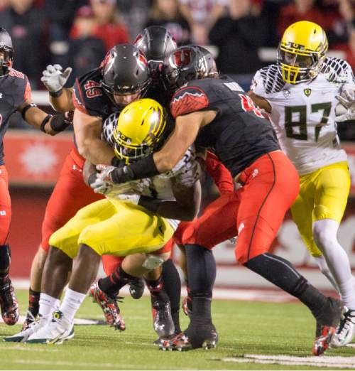 Rick Egan  |  The Salt Lake Tribune  The Utah defense stops Oregon Ducks running back Royce Freeman (21), in PAC-12 action, Utah vs. Oregon game, at Rice-Eccles Stadium, Saturday, November 8, 2014