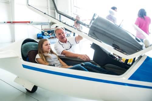 Chris Detrick     The Salt Lake Tribune Paul R. Schneider shows Charlotte Krippner, 13, of Tooele, a LS8-A Sailplane during ìGirls in Aviation Dayî at TacAir Hanger 6 Saturday September 26, 2015.
