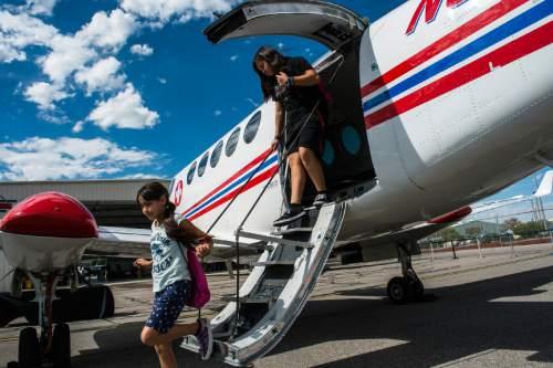 Chris Detrick     The Salt Lake Tribune Keira Walk, 11, and her sister Kayla Walk, 14, of Magna look at a LifeFlight airplane during ìGirls in Aviation Dayî at TacAir Hanger 6 on Saturday.