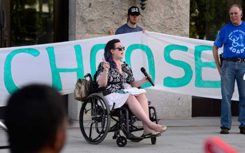 Scott Sommerdorf      The Salt Lake Tribune Westminster student Stacy Stanford spoke about the need for Medicaid expansion in Utah as nearly 200 members of ADAPT, the national grassroots advocacy group for disability rights, rallied at the Utah Capitol, Sunday, September 26, 2015.