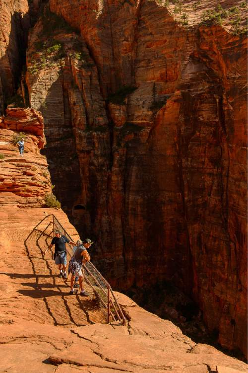 Trent Nelson  |  The Salt Lake Tribune Hikers on the Canyon Overlook Trail, Zion National Park, Tuesday May 5, 2015.