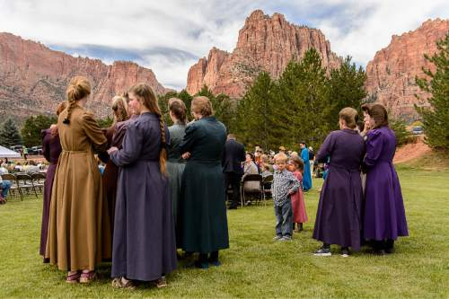 Trent Nelson  |  The Salt Lake Tribune Attendees at a memorial for the 13 (and 1 still missing) victims of a September 14th flash flood. The memorial was held in Maxwell Park in Hildale, Saturday September 26, 2015.