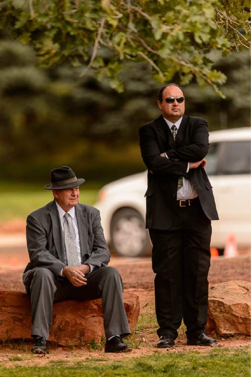 Trent Nelson  |  The Salt Lake Tribune Former Colorado City Mayor Dan Barlow, seated, at a memorial for the 13 (and 1 still missing) victims of a September 14th flash flood. The memorial was held in Maxwell Park in Hildale, Saturday September 26, 2015.