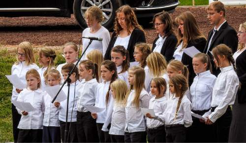 Trent Nelson  |  The Salt Lake Tribune A youth choir from the Kingston polygamist group sings at a memorial for the 13 (and 1 still missing) victims of a September 14th flash flood. The memorial was held in Maxwell Park in Hildale, Saturday September 26, 2015.