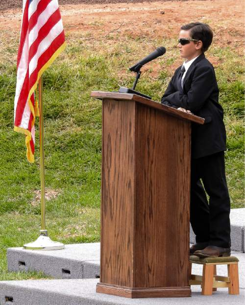 Trent Nelson  |  The Salt Lake Tribune Joseph Jessop, Jr., speaks at a memorial for the  victims of a Sept. 14 flash flood. Thirteen were killed and one is still missing. The memorial was held in Maxwell Park in Hildale, Saturday Sept. 26, 2015. Jessop is the only survivor of the flood.